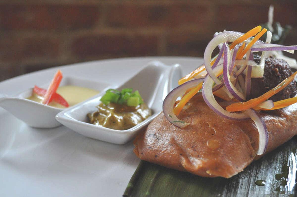 Peruvian style tamale with salsa criolla and huancaina sauce at Latin Bites.