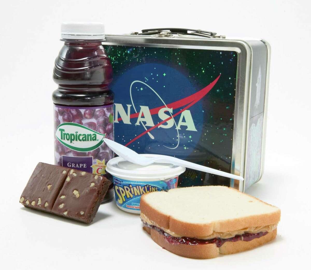 2005: NASA lunchbox with sandwich, yogurt, brownie, and grape juice. (Photo by John B. Carnett/Bonnier Corporation via Getty Images)
