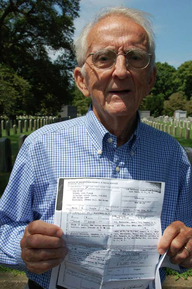 Darien resident John Boland, an 89-year-old veteran of World War II, shares a copy of his discharge papers from the Navy. Photo: Jarret Liotta / Freelance Photo / Stamford Advocate