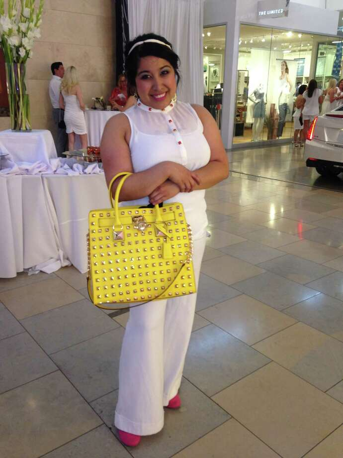 Miranda Gonzaba is one cool woman in a white-hot ensemble: a sleeveless sheer top over wide-legged line trousers. She accessorizes her crisp summer outfit with a white headband worked into her chic updo, and on her feet, rosy ballet flats that match the buttons on her top and the hue on her lips. But it's her bold yellow Michael Kors studded handbag that has us drooling. -Michael Quintanilla Photo: Photo By Michael Quintanilla / San Antonio Express-News
