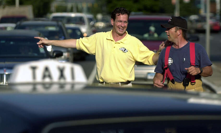 Stamford mayor Dannel Malloy and an Jim Kelley of the Stamford Fire and Rescue Department direct traffic at the intersection of Washington and Tresser boulevards during the blackout on August 14, 2003. Photo: File