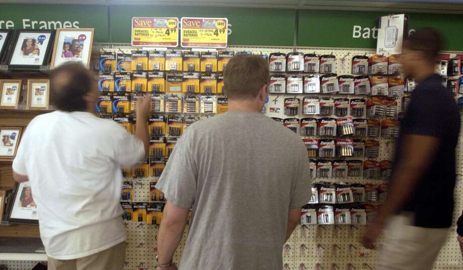 Shoppers try to find the right size batteries at Super Stop and Shop in Stamford. The store was out of D-cell batteries. Photo: Andrew Sullivan, File