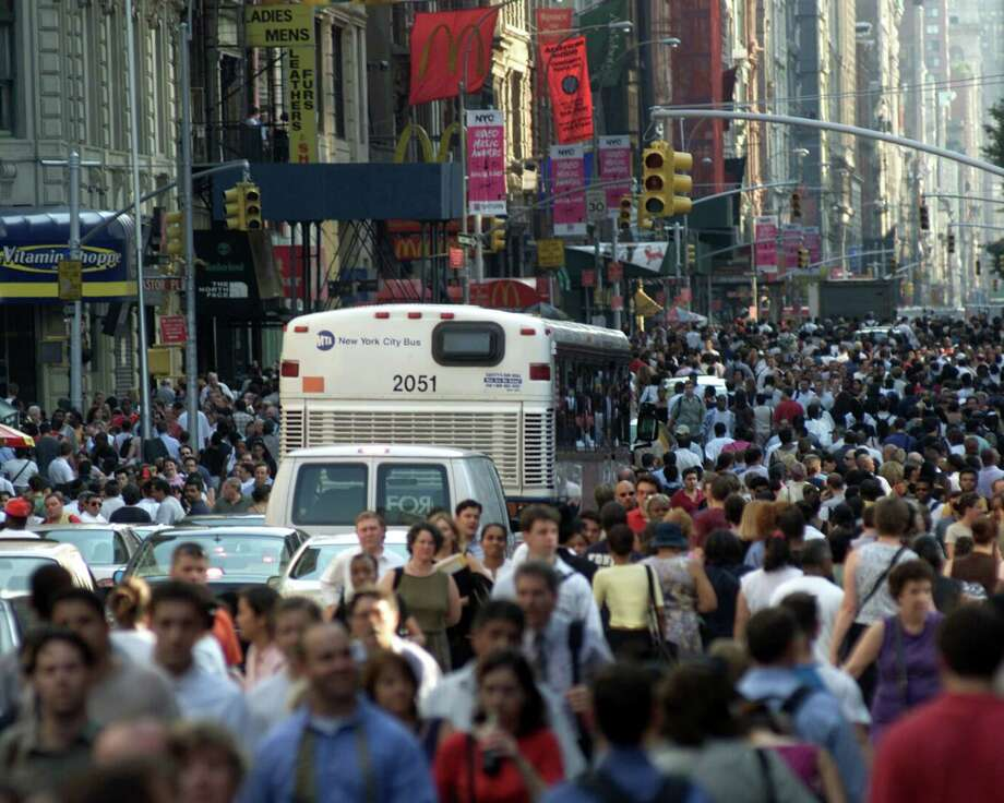 Pedestrians pack the street as they stream down Broadway in Greenwich Village, New York City, Aug. 14, 2003. New York was hit by the largest power blackout in American history. More than 50 million people were affected by the outage, in Toronto, Detroit, Cleveland and New York City. Photo: Paul Hawthorne, File / WireImage