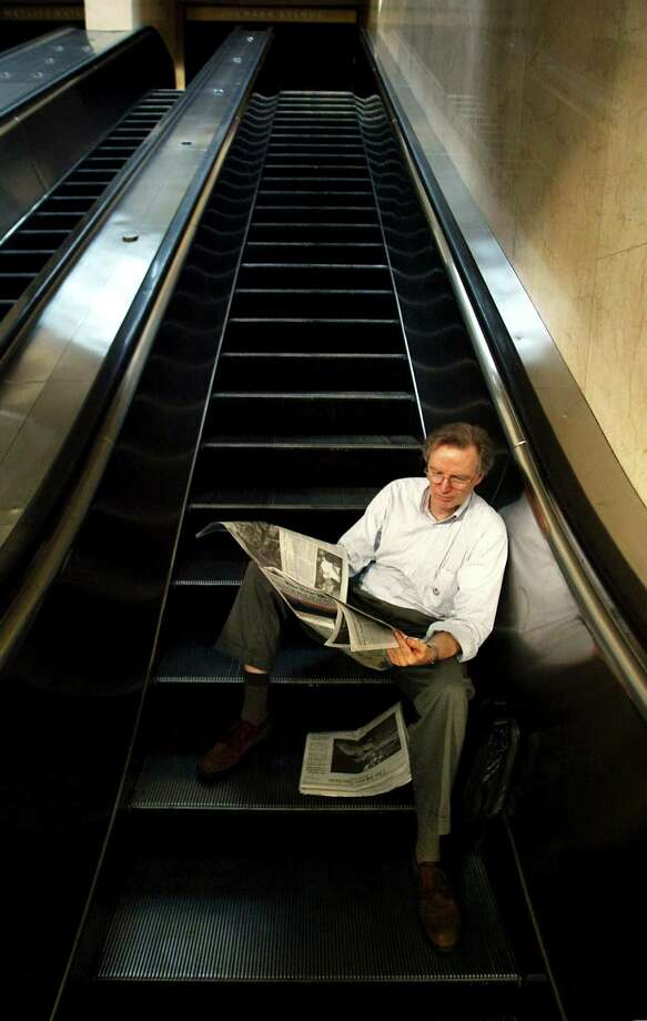 Stranded commuter Joe Thompson reads a newspaper in Grand Central Station during a massive blackout August 15, 2003 in New York City. Power is slowly returning to certain parts of the city. Photo: Mario Tama, File / 2003 Getty Images