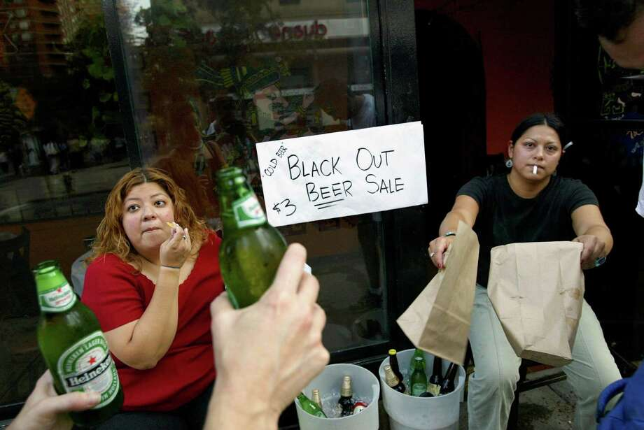 People sell beer on the street  during a massive blackout August 14, 2003 in New York City. Officials from the Department of Homeland Security said there were no indications that terrorists were responsible for the blackout that has also affected Ohio, and Canada. Photo: Spencer Platt, File / 2003 Getty Images