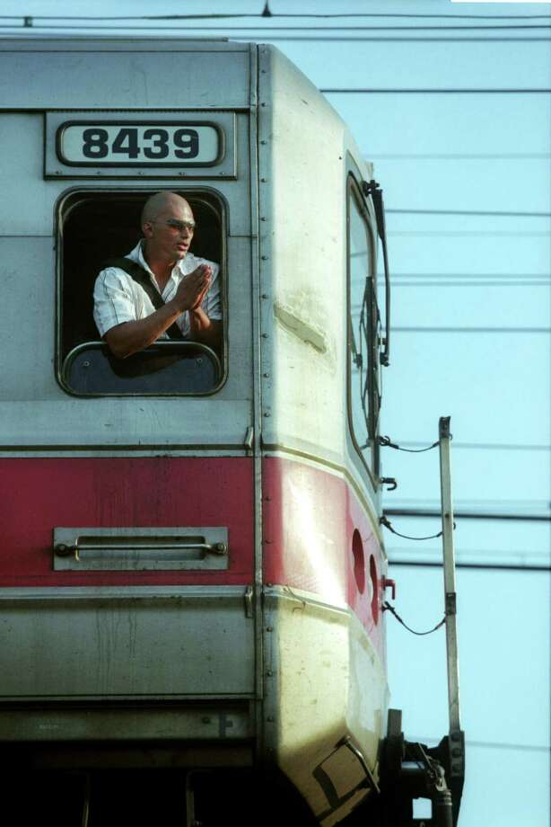 Jose Alarcon of Brooklyn, NY pleads for a ride from passing motorists from a window of a Metro North train stranded in Bridgeport, Conn. during the power blackout, Aug. 14, 2003. He eventually caught a ride with a driver going to New Haven. The stranded train was traveling from New Haven to New York. Photo: Ned Gerard, File / Connecticut Post
