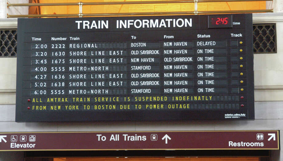 "The information board at the New Haven, Conn. train station reads ""all amtrak train service is suspended indefinately from New York to Boston due to power outage"", Aug. 15, 2003. Photo: File Photo/Jeff Bustraan, File / Connecticut Post File Photo"