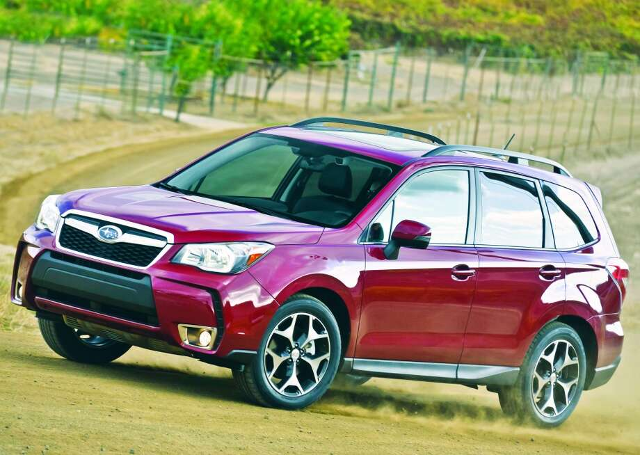 Resolution: Enjoy the outdoorsThe 2014 Subaru Forester is the perfect vehicle for your new outdoorsy lifestyle. The Forester's high ground clearance and low center of gravity allow it to go wherever you desire, while still maintaining its stability.