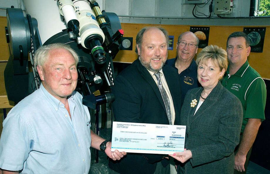 On hand for the presentation of a $3,000 grant from UTC Aerospace Systems to the McCarthy Observatory are, from left to right, front, the observatory's Monty Robson, UTC's Tom Danckwerth and Dr. JeanAnn Paddyfote, New Milford's superintendent of schools; and, back, the observatory's Bob Lambert and New Milford High School Principal Greg Shugrue. August 2013   Courtesy of Bill Quinnell Photo: Contributed Photo