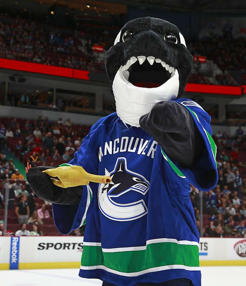 Vancouver Canucks mascot Fin IS COMING FOR YOU with his vampire fangs. Photo: Jeff Vinnick, NHLI Via Getty Images
