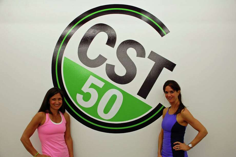 Felice Marcy, right, and Annabel Marisca are the co-owners of CST 50 in Darien, the area's territory for the Megaformer, a piece of exercise equipment that gives high-level cardio and muscle workouts with low impact of stress on the body. Jarret Liotta/For the Darien News Photo: Contributed