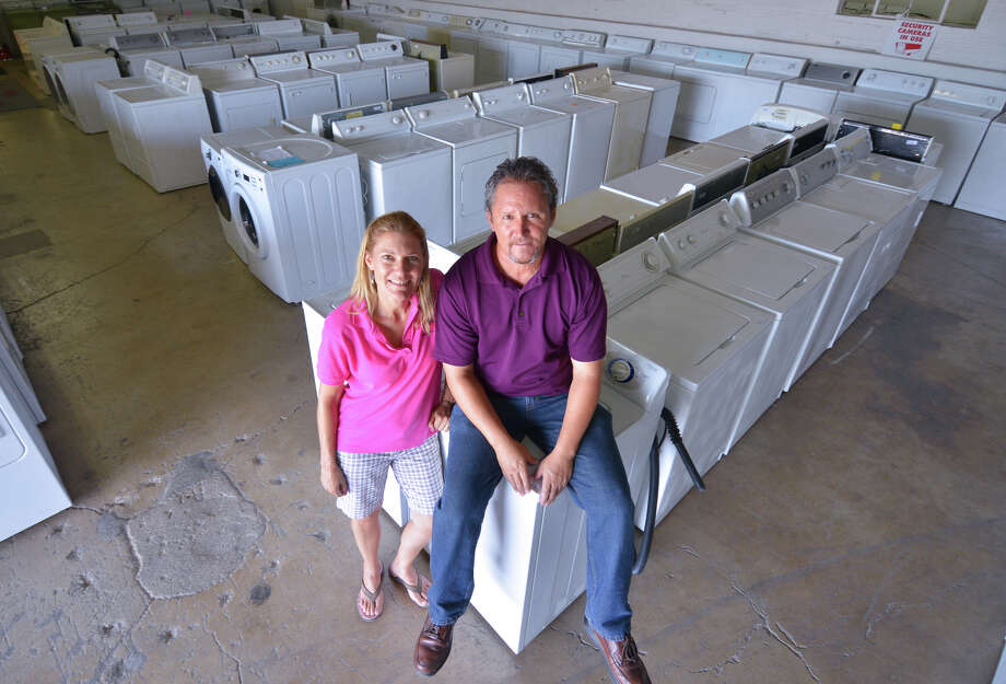 Kim and Carlos Fraire own the Appliance Liquidation Outlet at 500 Carolina St. Photo: Robin Jerstad