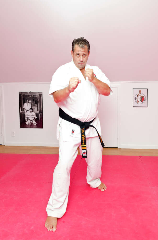Jay Servidio stands in his karate dojo, Jay Dojo, on Jelliff Mill Road in New Canaan on Monday, Aug. 12, 2013. Photo: Amy Mortensen / Connecticut Post Freelance