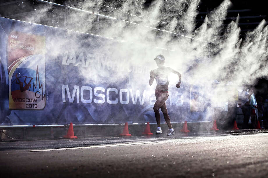 A competitor goes through the misting station during the Women's 20km Race Walk during Day Four of the 14th IAAF World Athletics Championships Moscow 2013 at Luzhniki Stadium on August 13, 2013 in Moscow. Photo: Ian MacNicol, Getty Images / 2013 Ian MacNicol