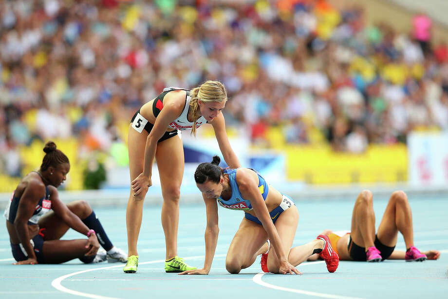 Hanna Melnychenko of Ukraine rests after the Women's heptathlon 800 metres during Day Four of the 14th IAAF World Athletics Championships Moscow 2013 at Luzhniki Stadium on August 13, 2013 in Moscow. Photo: Julian Finney, Getty Images / 2013 Getty Images