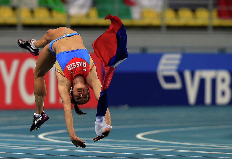Elena Isinbaeva of Russia celebrates winning gold in the Women's pole vault final during Day Four of the 14th IAAF World Athletics Championships Moscow 2013 at Luzhniki Stadium on August 13, 2013 in Moscow. Photo: Jamie Squire, Getty Images / 2013 Getty Images
