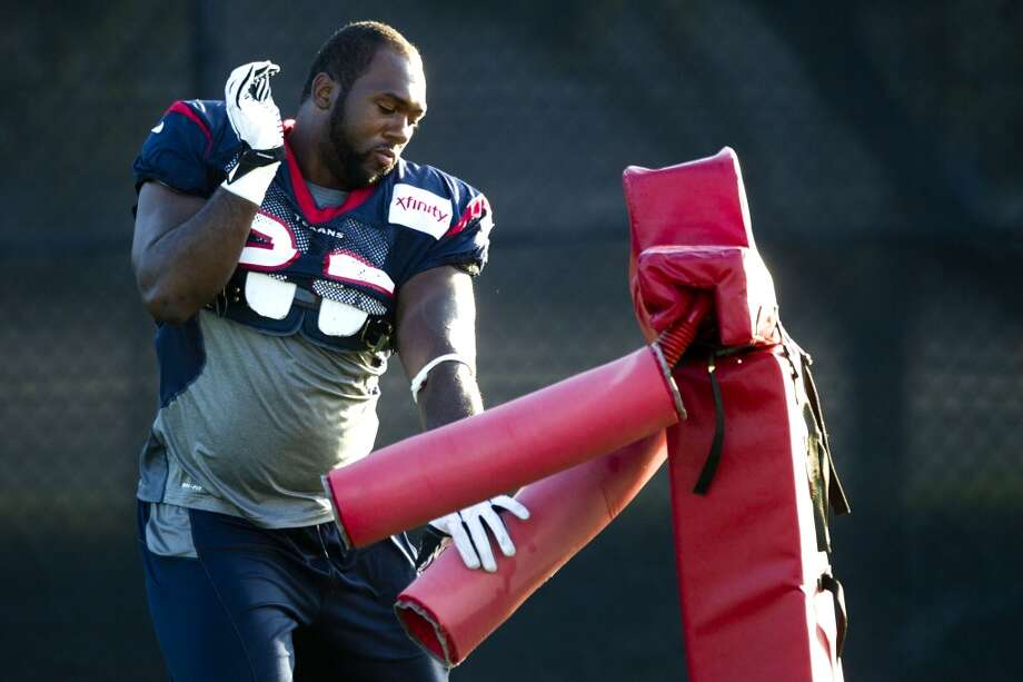 Nose tackle Earl Mitchell warms up before practice. Photo: Brett Coomer, Chronicle
