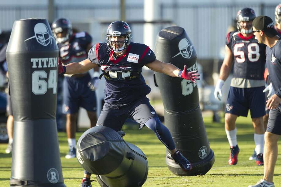 Inside linebacker Brian Cushing hits a blocking dummy. Photo: Brett Coomer, Chronicle