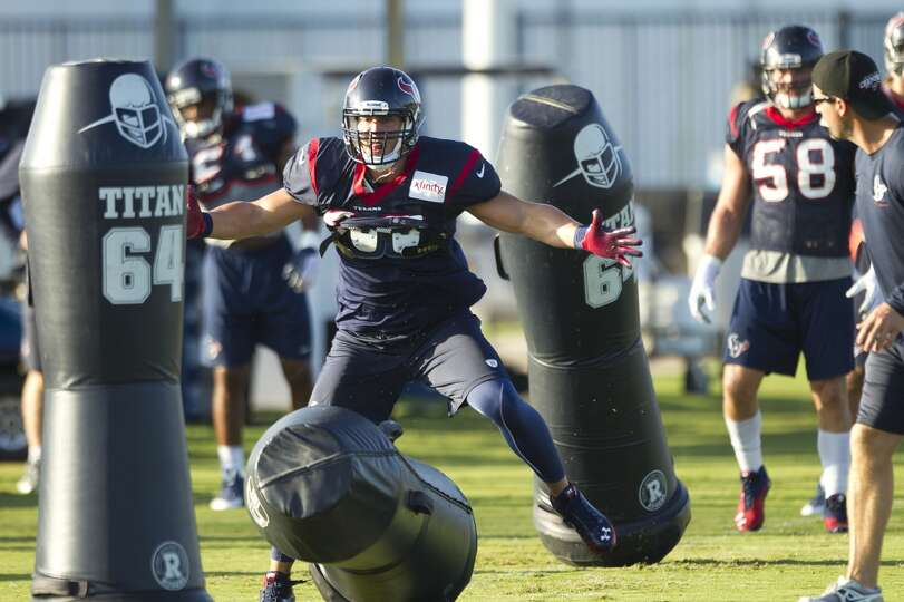 Inside linebacker Brian Cushing hits a blocking dummy.