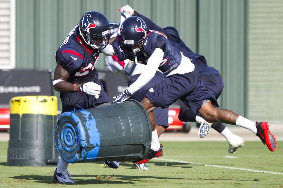 Defensive back Roc Carmichael (22) and Elbert Mack (43) run through special teams drills Photo: Brett Coomer, Chronicle
