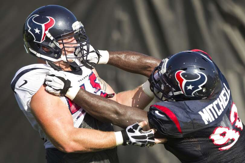 Texans center Chris Myers (55) and nose tackle Earl Mitchell (92) go one-on-one.