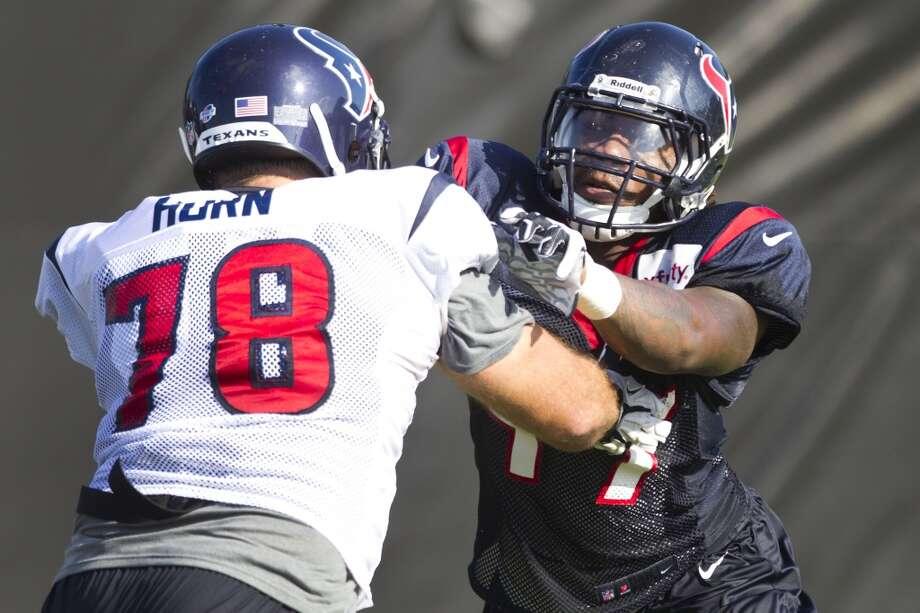 Linebacker Justin Tuggle goes up against center Tyler Horn during a pass rush drill. Photo: Brett Coomer, Chronicle