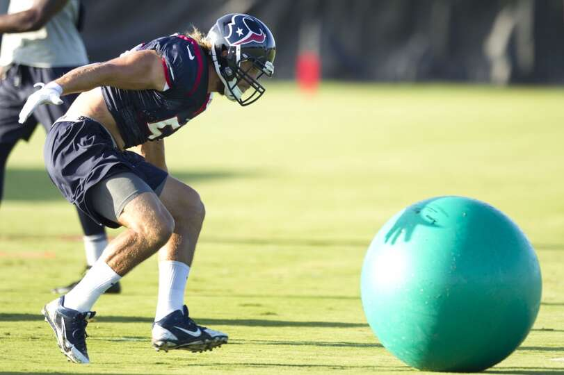 Linebacker Bryan Braman runs to hit a rubber ball.