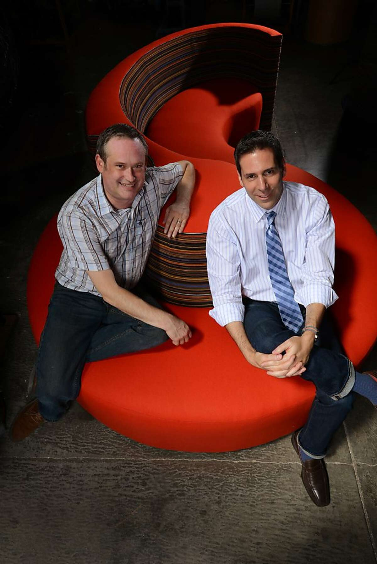 Jim Berrens, left, of Cypress Furniture with designer Michael Friedes on a custom made Serpentine Lounge chair produced by Berrens at Cypress Furniture in Hayward, California. July 26, 2013.