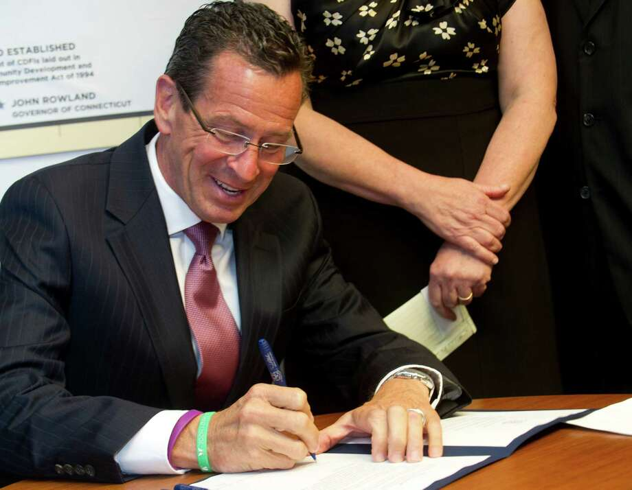 Connecticut Governor Dannel Malloy speaks during a bill-signing ceremony for a law regarding protections for homeowners facing foreclosure at the Housing Development Fund offices in Stamford, Conn., on Tuesday, August 13, 2013. Photo: Lindsay Perry / Stamford Advocate