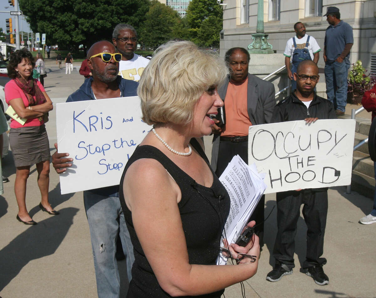 After being told to leave the Memorial building in Topeka Monday, Sept. 17, 2012, Orly Taitz, a California lawyer and dentist, talks to media as those that disagree with her hold signs(AP Photo/Topeka Capital-Journal, Thad Allton/archive)