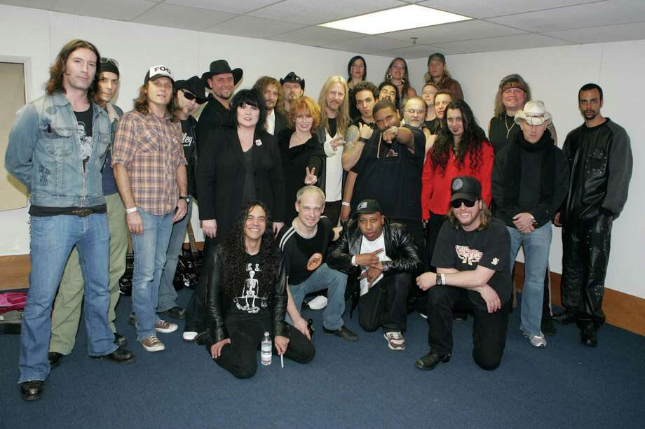 Pictured in a publicity photo for a tsunami relief benefit album, Ann Wilson and Nancy Wilson from Heart, members of Alice in Chains, Sean Kinney, Jerry Cantrell, Mike Inez with Pat Lachman from Damage Plan, Chris DeGarmo of Queensryche, Wes Scantlin of Puddle of Mudd, Maynard James Keenan of A Perfect Circle, Supersuckers, Outtasite featuring Sir Mix-a-Lot, and Children of the Revolution. Photo: Kevin Casey, Getty Images / WireImage