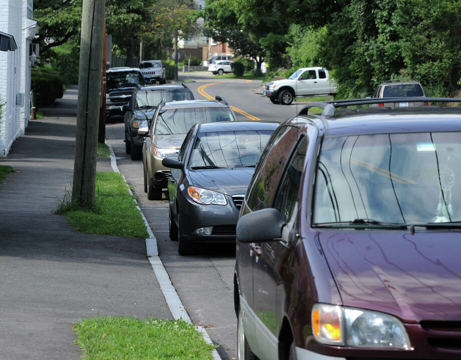 Vehicles parked on lower Pemberwick Road in the Pemberwick section of Greenwich, Tuesday, August 13, 2013. Recent cases of vandalism to vehicles parked in the 50 to 100 stretch have been reported by residents to the police but are unsolved. Photo: Bob Luckey / Greenwich Time