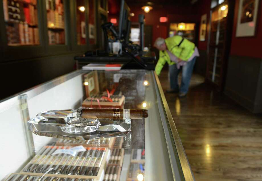 M. Hanlon, of Monroe, browses the selection of cigars at Cigar Republic in Danbury, Conn. on Tuesday, Aug. 13, 2013.  The cigar store and lounge opened on Monday, Aug. 12 and features a variety of premium cigars and cigar accessories. Photo: Tyler Sizemore / The News-Times