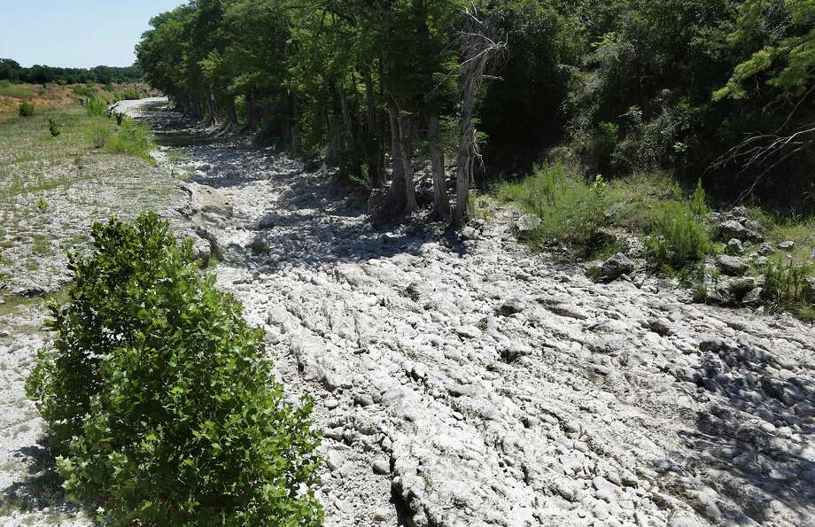 The dry bed of the Guadalupe River at the Rebecca Creek Rd. crossing looks like a skeleton river, with no flow.  Tuesday, August 13, 2013. Photo: Bob Owen, San Antonio Express-News / © 2012 San Antonio Express-News