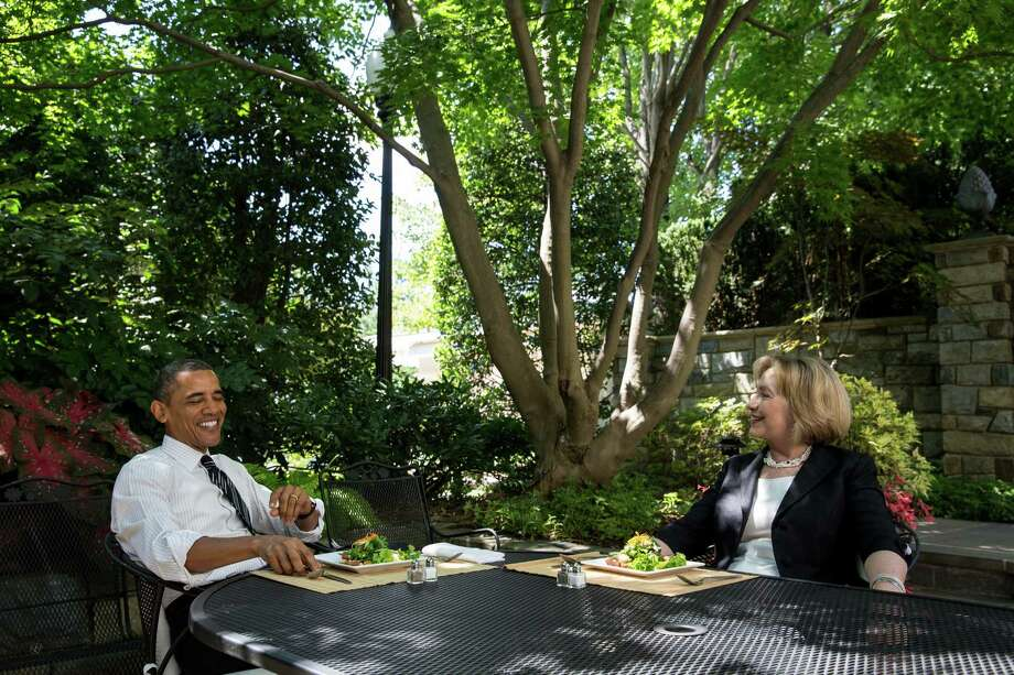 President Barack Obama has lunch with former Secretary of State Hillary Rodham Clinton on the patio outside the Oval Office. Obama has been naive in his willingness to open the door for Clinton Inc.'s return. Photo: Courtesy Photo Via Getty Images
