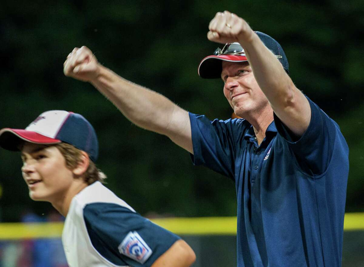 Westport, Conn. manager Tim Rogers celebrates winning the Little League 12-year-old New England championship game against Lincoln, RI played at Breen Field, Bristol, CT on Saturday, August 10th, 2013.