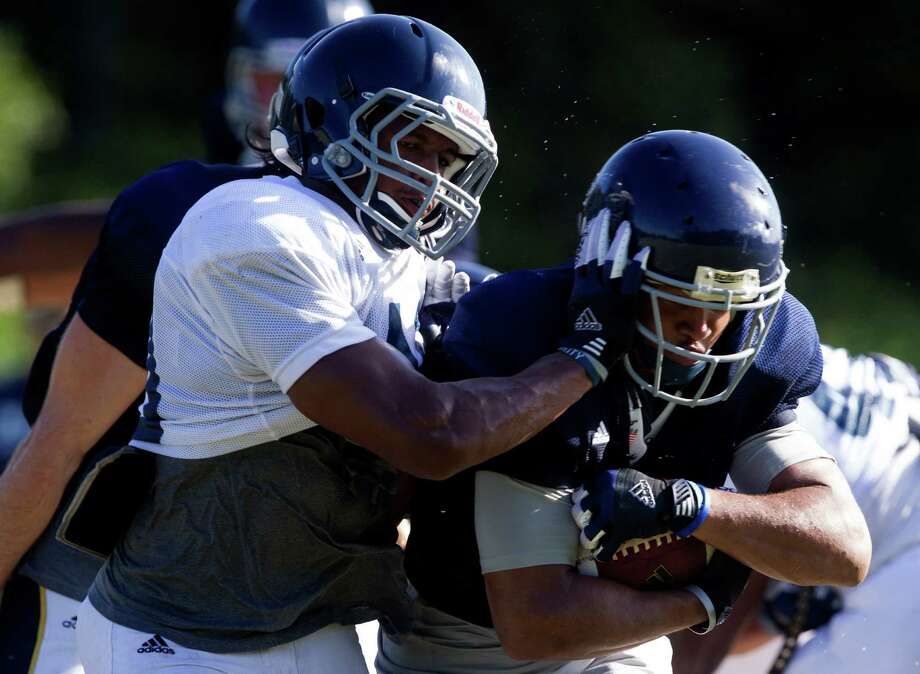 Rice running back Darik Dillard and safety Gabe Baker, left, run through plays at practice on Tuesday, Aug. 13, 2013, in Houston. Photo: J. Patric Schneider, For The Chronicle / © 2013 Houston Chronicle
