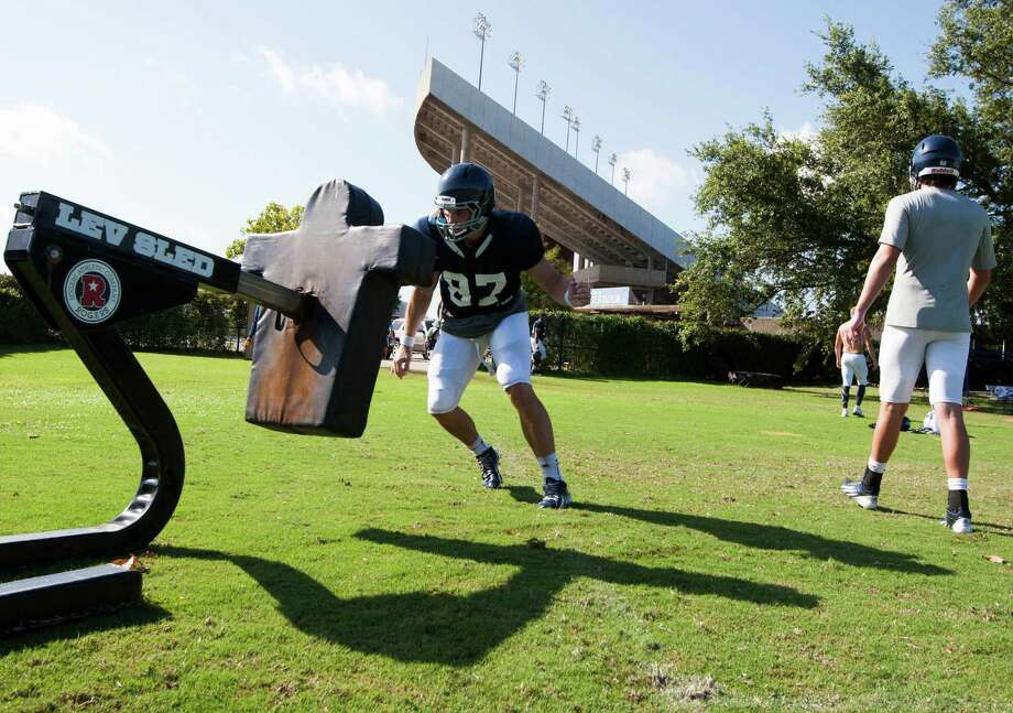 Rice tight end Connor Cella practices on the tacking dummy on Tuesday, Aug. 13, 2013, in Houston. Photo: J. Patric Schneider, For The Chronicle / © 2013 Houston Chronicle
