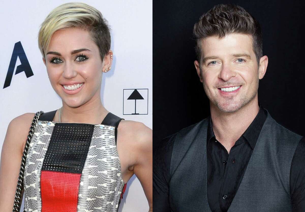 This combination of August 2013 file photos shows Miley Cyrus, left, in Los Angeles and Robin Thicke in New York. Cyrus and Thicke are scheduled to perform their summer anthems at the MTV Video Music Awards on Aug. 25, 2013. (Photo by Jordan Strauss, Victoria Will/Invision/AP) ORG XMIT: NY118