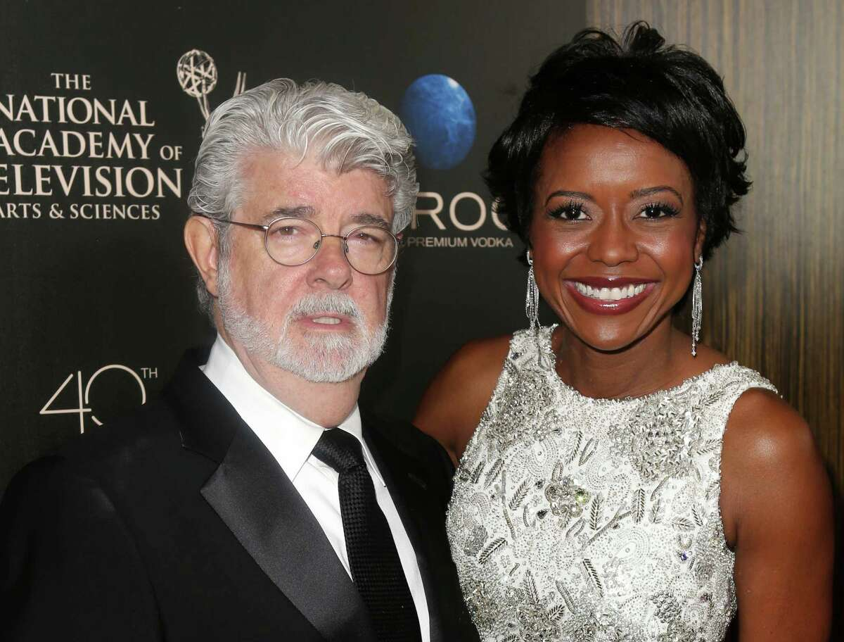 FILE - This June 16, 2013 file photo released by Entertainment Fusion Group shows producer George Lucas, left, and his wife Mellody Hobson at The 40th Annual Daytime Emmy Awards in Beverly Hills. Lucas and his wife Mellody Hobson have had a baby daughter, born via surrogate. Representatives for the 69-year-old filmmaker announced the birth Monday, Aug. 12. Everest Hobson Lucas was born Friday, the first child for Lucas and Hobson, who were married in June. (AP Photo/Entertainment Fusion Group, Ryan Miller) ORG XMIT: NYET217