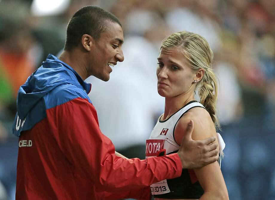 United States' Ashton Eaton, left, speaks with his wife Canada's Brianne Theisen Eaton after she placed second overall to win silver following the 800-meter heptathlon at the World Athletics Championships in the Luzhniki stadium in Moscow, Russia, Tuesday, Aug. 13, 2013. Photo: Ivan Sekretarev, Associated Press