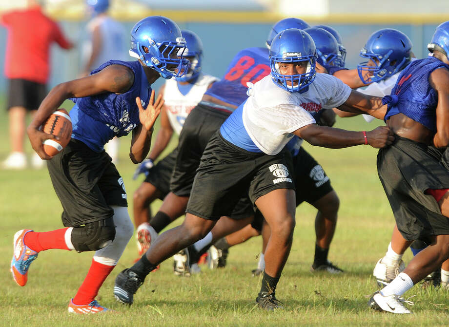 West Brook players practice on the Bruin's field Tuesday. West Brook will play Ozen on their season opening game. Photo taken Tuesday, August 13, 2013 Guiseppe Barranco/The Enterprise Photo: Guiseppe Barranco, STAFF PHOTOGRAPHER / The Beaumont Enterprise