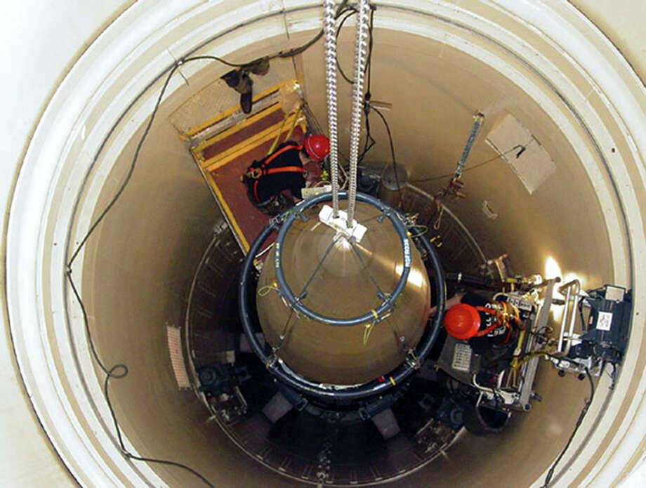 "In this image released by the U.S. Air Force, a Malmstrom Air Force Base missile maintenance team removes the upper section of an ICBM at a Montana missile site. An Air Force unit that operates one-third of the nation's land-based nuclear missiles at Malmstrom Air Force Base, Mont., has failed a safety and security inspection, marking the second major setback this year for a force charged with the military's most sensitive mission, Lt. Gen. James M. Kowalski, who is in charge of the nuclear air force told The Associated Press on Tuesday, Aug. 13, 2013. He said a team of ""relatively low ranking"" airmen failed one exercise as part of a broader inspection, which began last week and ended Tuesday. He said that for security reasons he could not be specific about the team or the exercise.  (AP Photo/U.S. Air Force, John Parie) Photo: John Parie, HOPD / U.S. Air Force"