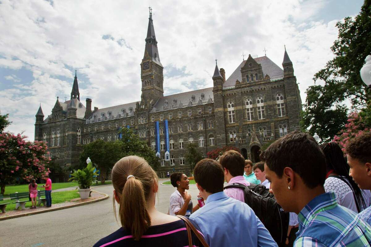 FILE - In this July 10, 2013, file photo, prospective students tour Georgetown University's campus in Washington. Despite all the grumbling about tuition increases and student loan costs, other college expenses also are going up. The price of housing and food trumps tuition costs for students who attend two- and four-year public universities in their home states. That?'s according to a College Board survey. Even with the lower interest rates on student loans that President Barack Obama signed into law, students are eyeing bills that are growing on just about every line. (AP Photo/Jacquelyn Martin, File) ORG XMIT: WX102