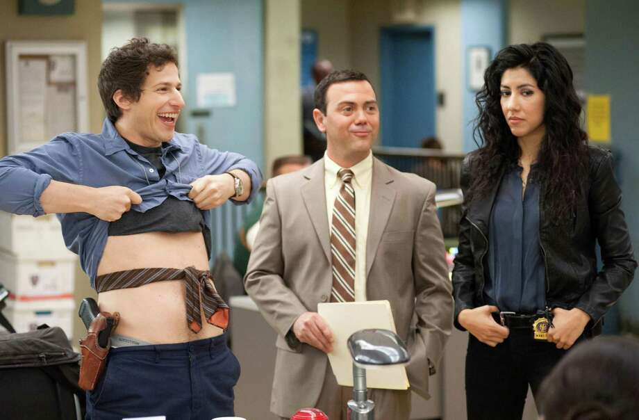 Andy Samberg, Joe Lo Truglio and Stephanie Beatriz in new Fox cop-comedy series 'Brooklyn Nine-Nine.'