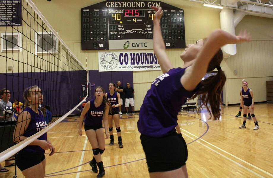 Boerne High School sophomore Morgan Stahl gets set to hit a return during last Saturday's scrimmages against Blanco and Floresville in the BHS gym.