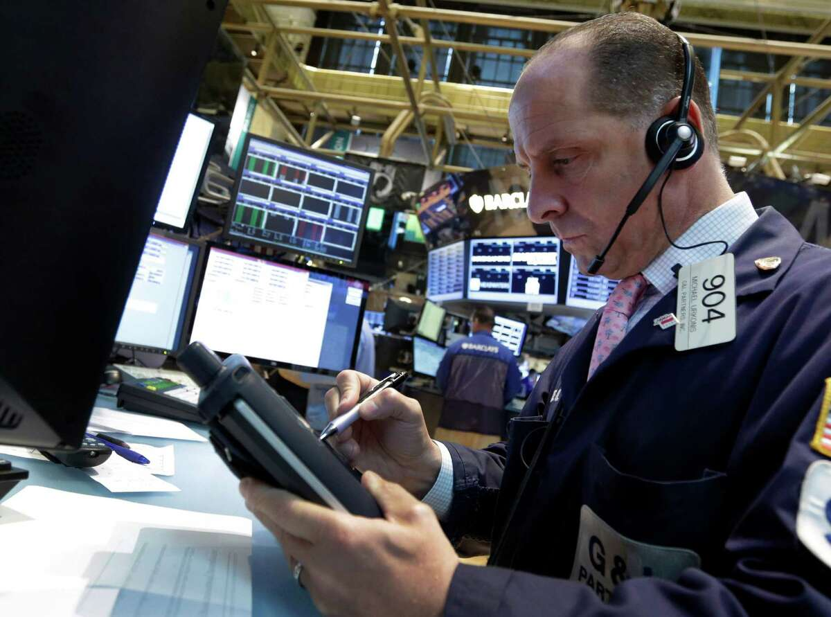 FILE - In this Wednesday, July 31, 2013, file photo, trader Michael Urkonis works on the floor of the New York Stock Exchange. Hopes over the European economy coupled with a strong bounce-back in Japan's Nikkei stock index shored up markets Tuesday, ahead of key U.S. retail sales data that could have a bearing on when the Federal Reserve starts to rein in its monetary stimulus. (AP Photo/Richard Drew, File) ORG XMIT: NYBZ101