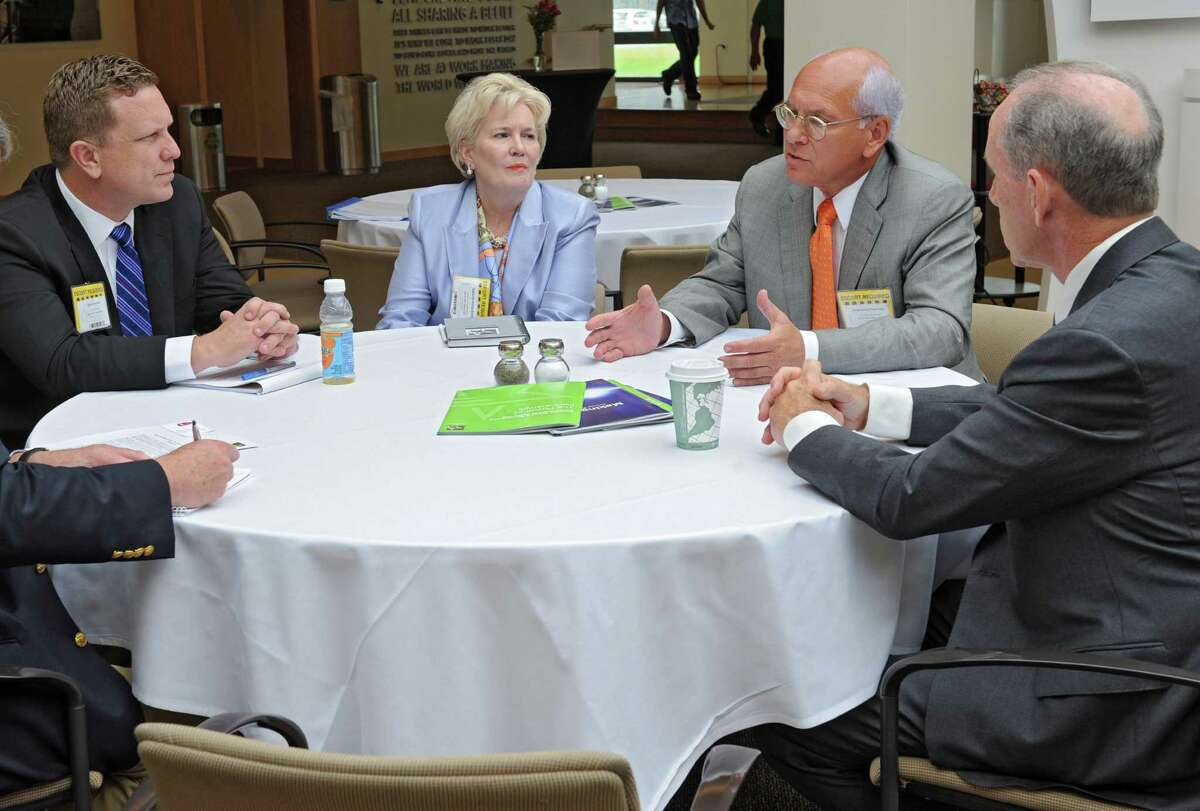 From left, David Danielson, assistant secretary for the Office of Energy Efficiency and Renewable Energy, Deborah Wince-Smith, president of the Council on Competitiveness, Congressman Paul Tonko and Mark Little, senior vice president and director of GE Global Research conduct a meeting of the Council on Competitiveness Tuesday morning, Aug. 13, 2013, at GE Global Research Center in Niskayuna, N.Y. (Lori Van Buren / Times Union)