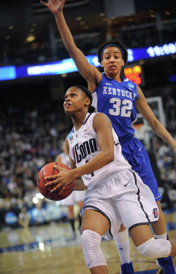 UConn's Moriah Jefferson drives to the basket ahead of Kentucky defender Kastine Evans during  the Huskies' 83-53 victory in the elite eight round of the NCAA Women's Basketball Tournament at the Webster Bank Arena in Bridgeport, Conn. on Monday, April 1, 2013. Photo: Brian A. Pounds / Connecticut Post