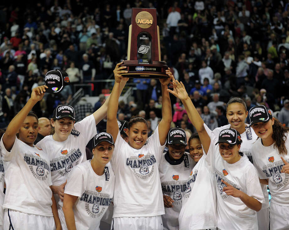 UConn player raise the Regional Championship trophy following their 83-53 victory over Kentucky in the elite eight round of the NCAA Women's Basketball Tournament at the Webster Bank Arena in Bridgeport, Conn. on Monday, April 1, 2013. Photo: Brian A. Pounds / Connecticut Post